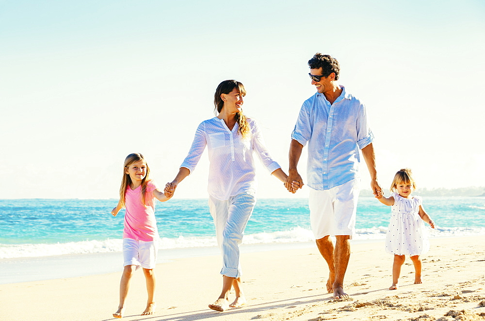 Happy Family Having Fun Walking On Tropical Beach