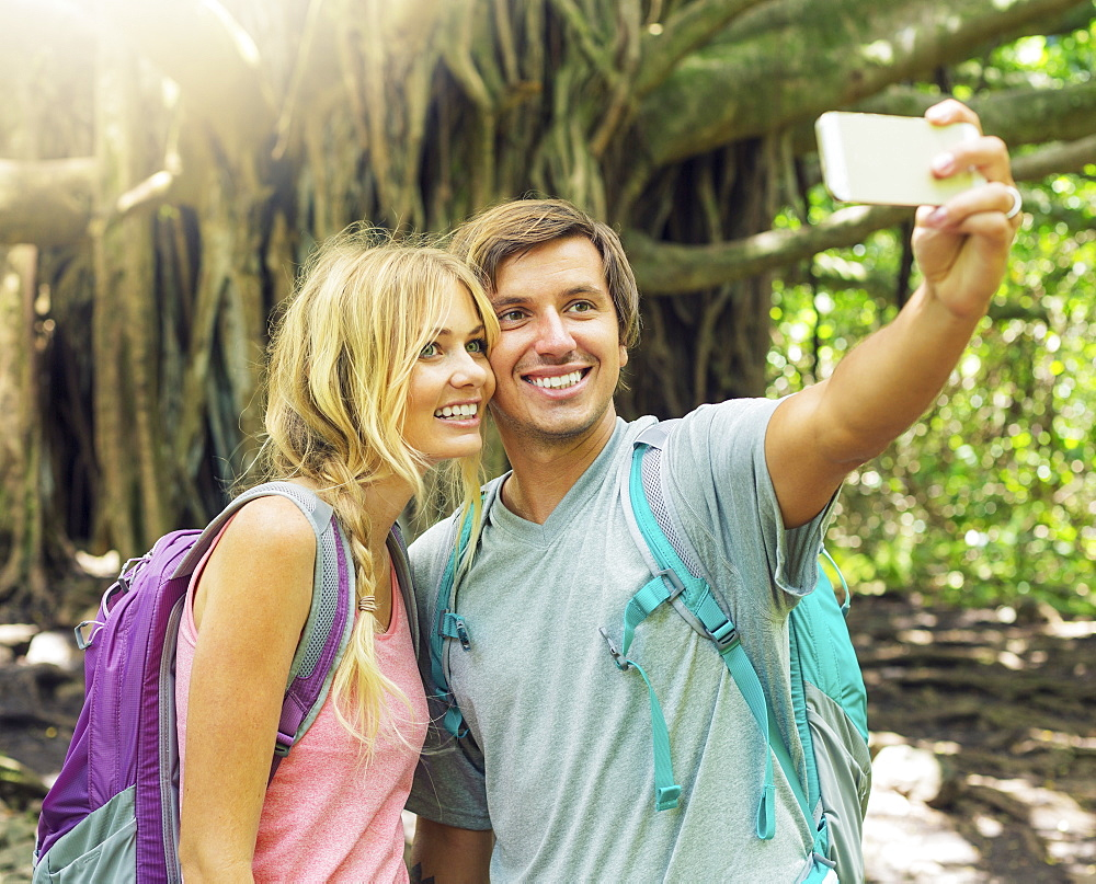 Couple Having Fun Together Outdoors. Taking Self Portrait With Camera Phone On Hike.