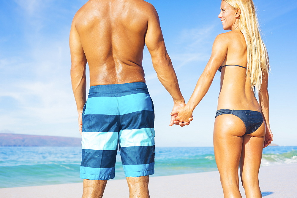 Attractive Couple On Sunny Tropical Beach Vacation