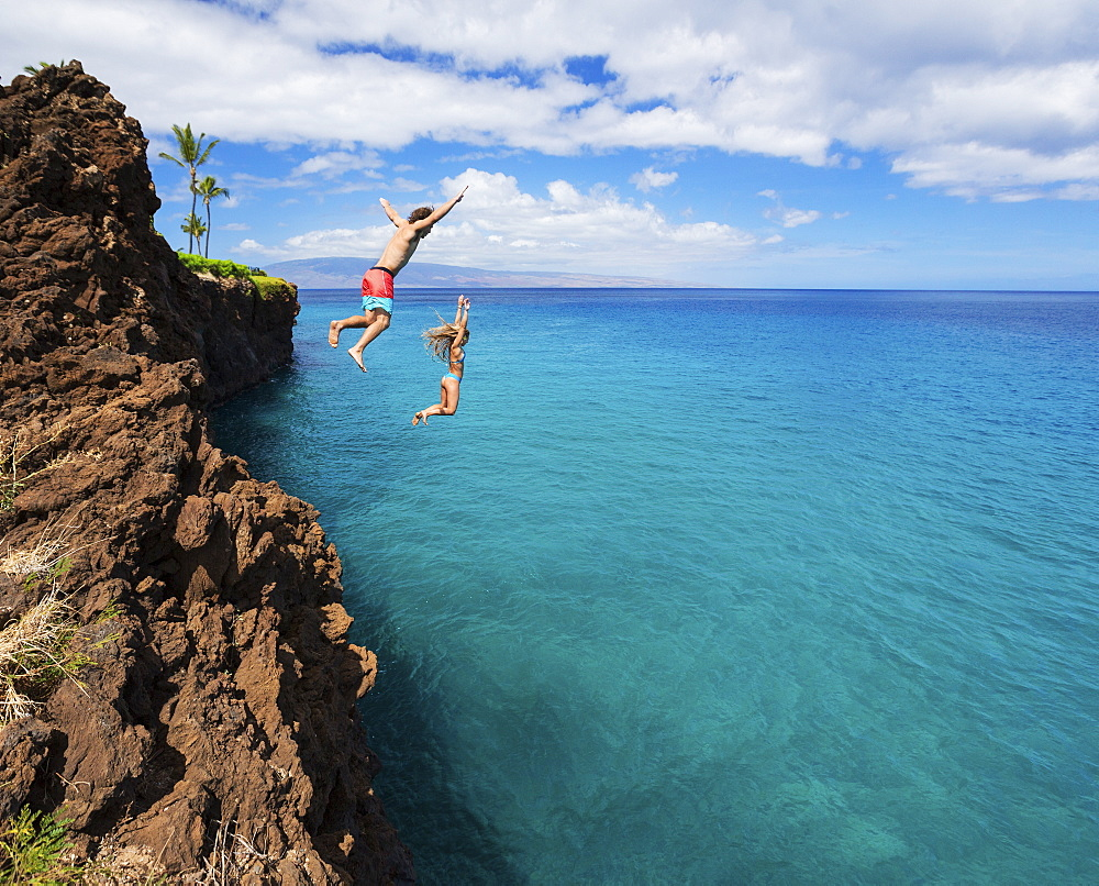 Summer Fun, Friends Cliff Jumping Into The Ocean.
