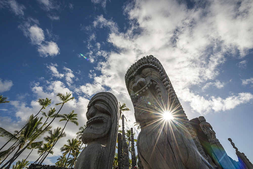 Afternoon Sun Shines Through Statues At Puuhonua O Honaunau National Historic Park, Island Of Hawaii, Hawaii, United States Of America