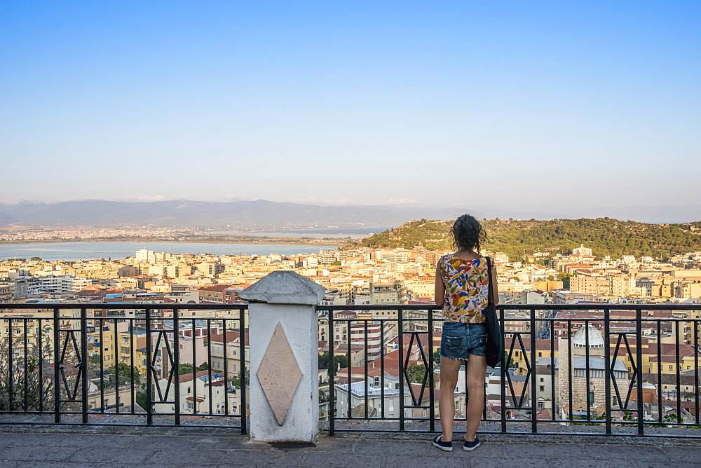 Girl Enjoying The Panoramic View Of The City Of Cagliari, Cagliari, Sardinia, Italy