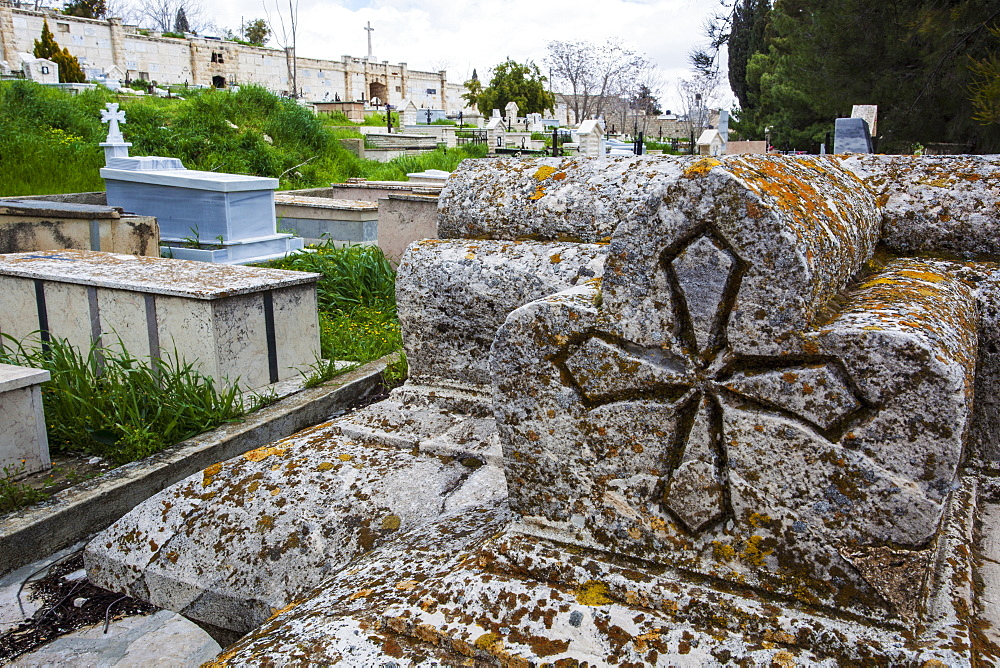 Old Tombstones In A Cemetery With A Carved Cross, Israel