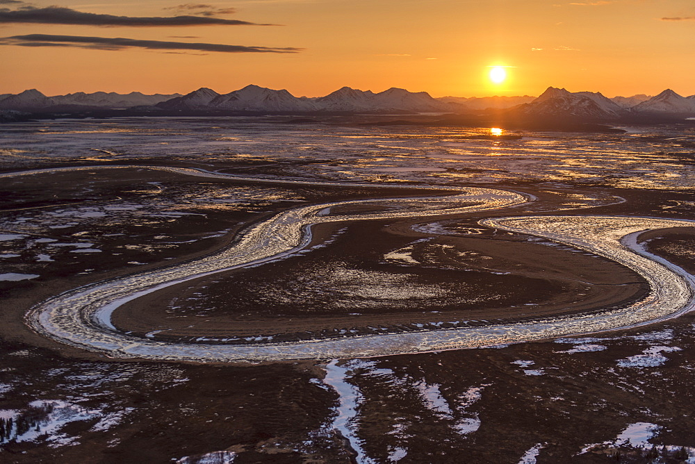 The Sun Sets Behind The Wood River Mountains And Snake River Within The Togiak National Wildlife Refuge, Alaska.