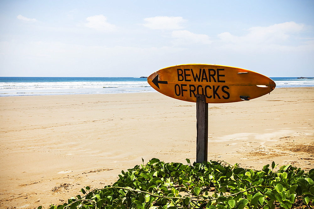 A Warning Sign On A Surfboard In Playa Hermosa, Nicaragua