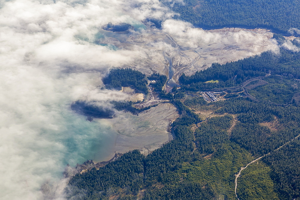 Aerial View Of Clouds Obscuring The Mud Flats During Low Tide Along The Shores Of Rural Ketchikan, Southeast Alaska, USA, Spring