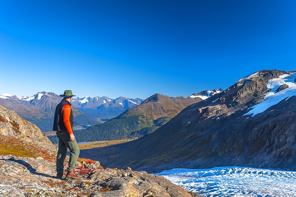 A Man Hiking Near An Unnamed Lake Near The Harding Icefield Trail In Kenai Fjords National Park On A Summer Day, South-Central Alaska, Alaska, United States Of America - 1116-46128