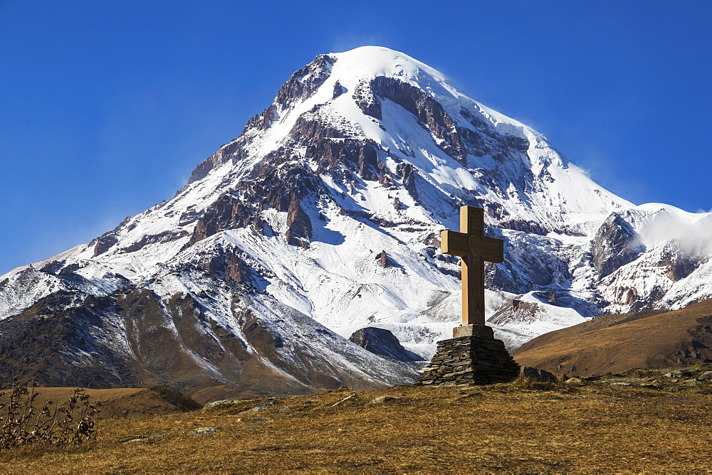 Stone Cross With Mount Kazbek In The Background, Kazbegi, Mtskheta-Mtianeti, Georgia
