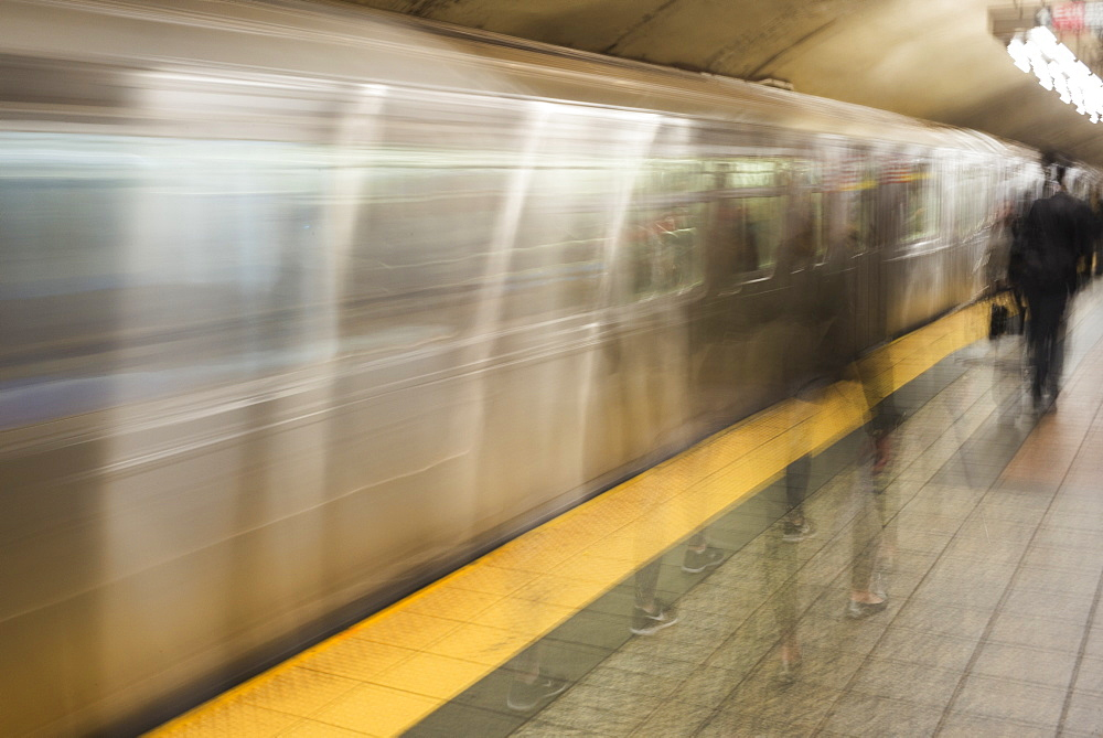 Motion Blur Of Passengers Walking On The Platform Beside The Moving Subway, New York City, New York, United States Of America
