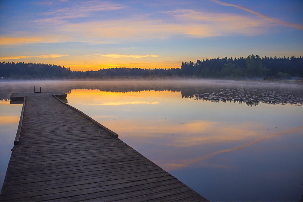 Reflection Of A Beautiful Serene Sunrise On Peaceful Scott Lake, Washington, United States Of America