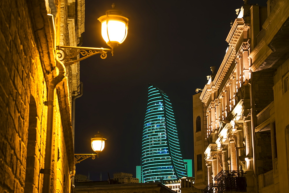 Mansions On Boyuk Qala Street With The Flame Towers In The Background At Night, Baku, Azerbaijan