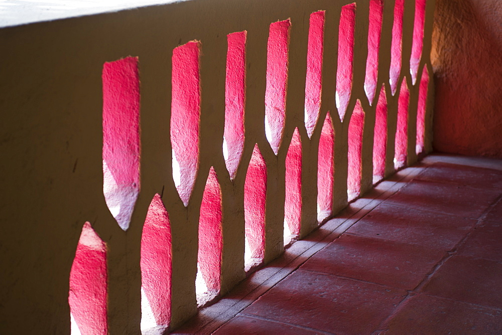 Light And Shadow Through A Mexican Pink Painted Stucco Wall, Ixtapa, Mexico