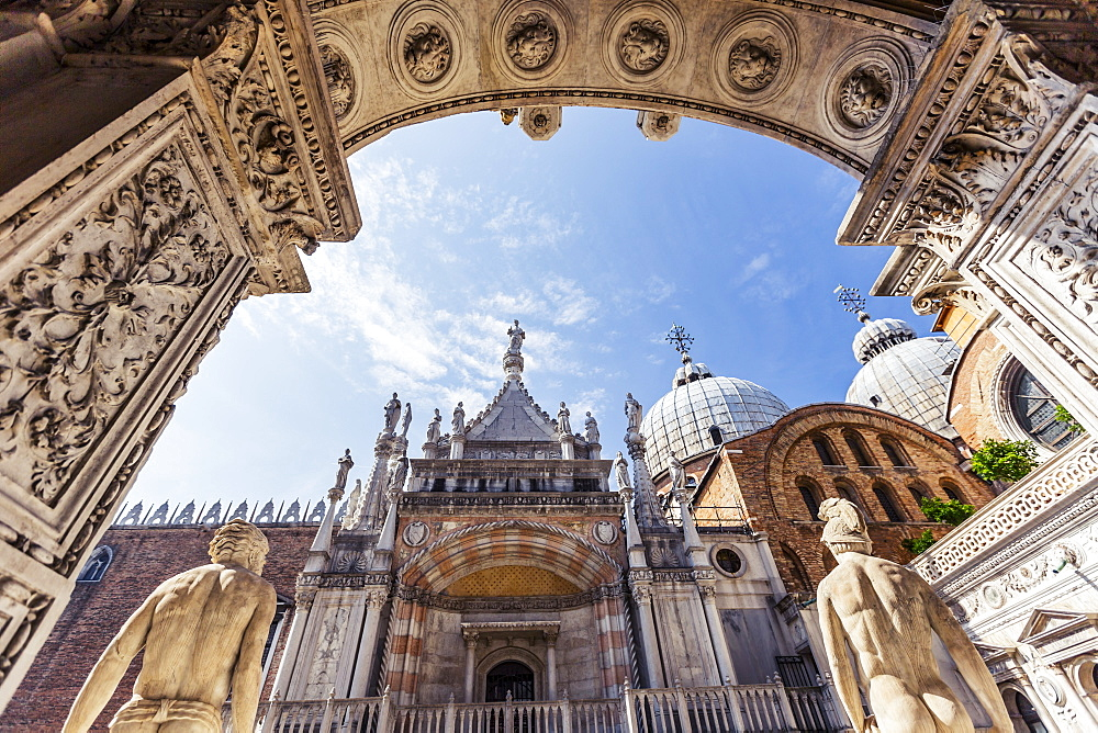 Low Angle View Looking Out Towards The Chapel And St Mark's Basilica Through The Courtyard Of Doge's Palace, Palazzo Dulce, Venice, Italy
