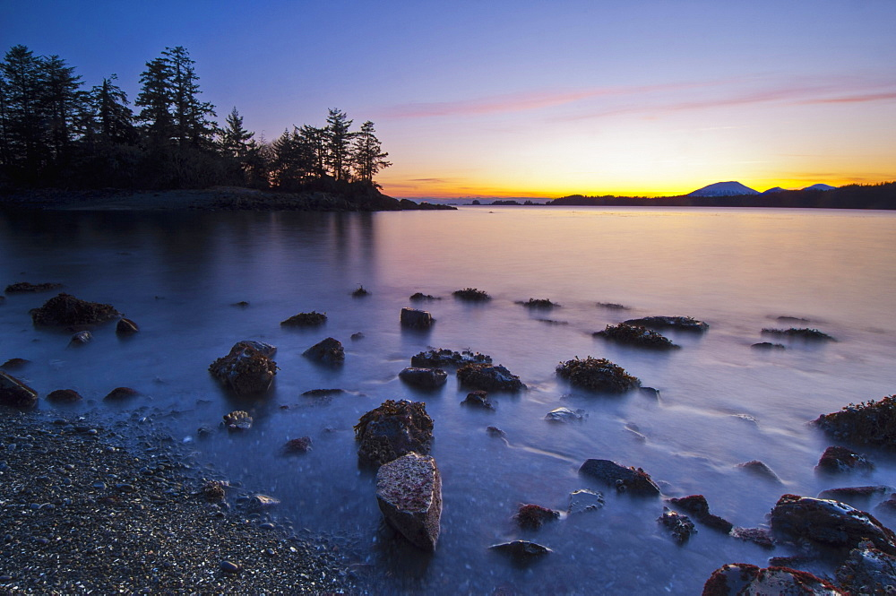 Colors Of Dusk And Incoming Surf At Halibut Point Recreation Area With View Of Magic Island, Sitka, Alaska, United States Of America