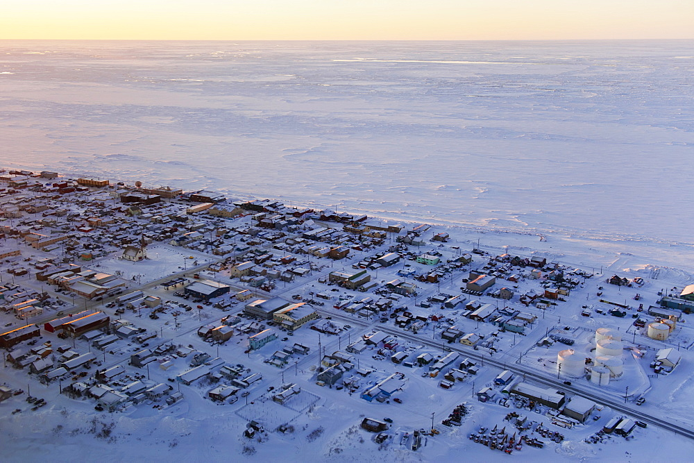 Aerial Sunrise View Of The Village Of Nome On The Seward Peninsula And The Frozen Bering Sea, Nome, Alaska, United States Of America