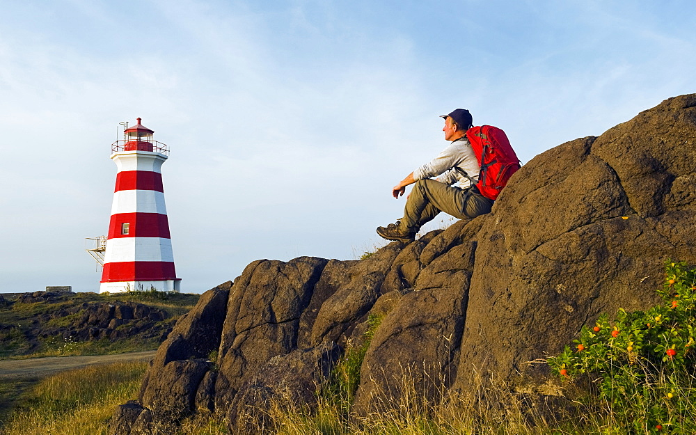 Hiker Looking Out Over Brier Island Lighthouse, Brier Island, Bay Of Fundy, Nova Scotia, Canada - 1116-46454