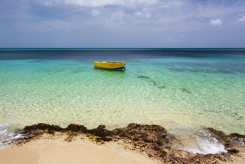 A Lone Boat In The Turquoise Water Off A Tropical Island, Frederiksted, St. Croix, Virgin Islands, United States Of America