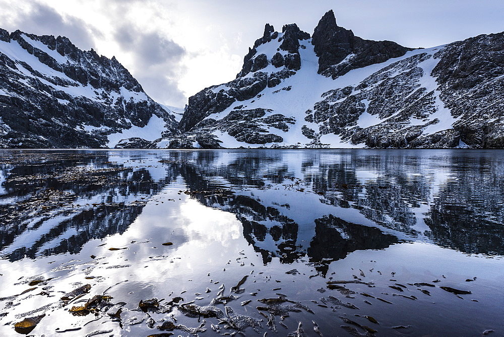 Reflections Of Snow Covered Rugged Mountains In Water, Antarctica