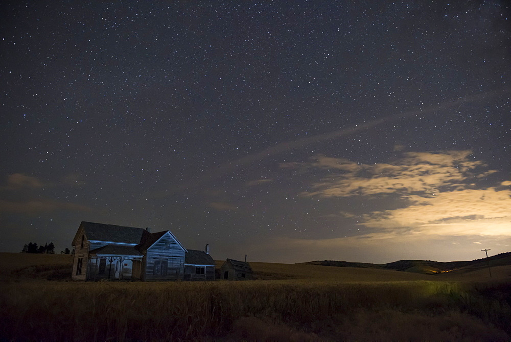 Stars Glowing In The Sky At Dusk Over A Farmhouse, Palouse, Washington, United States Of America