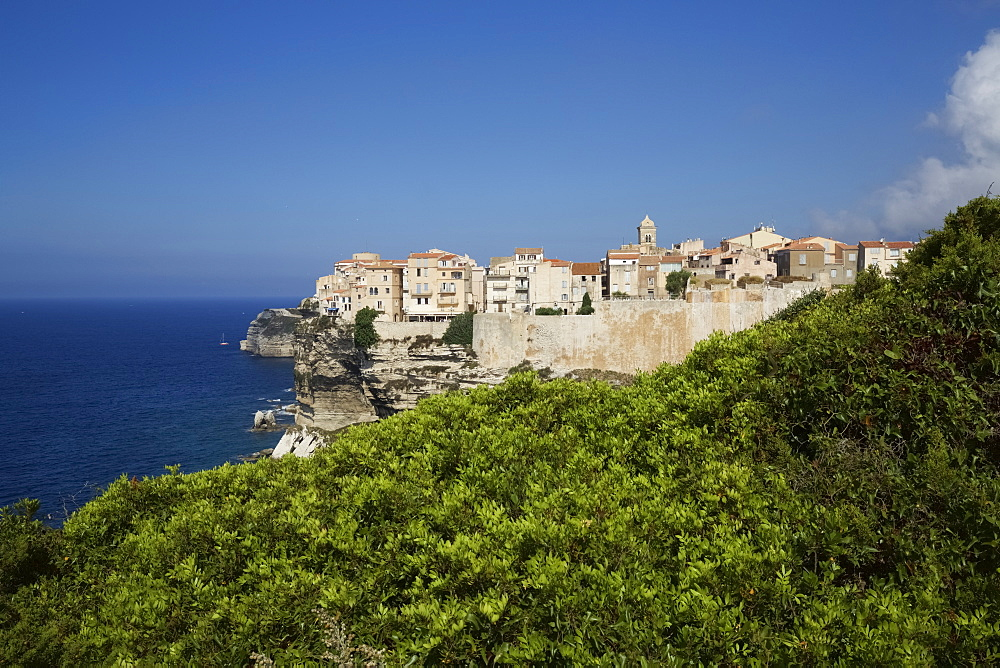 View Of Bonifacio Citadel Perched On Cliffs With Blue Sea, Corsica