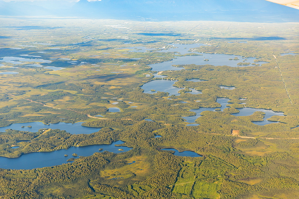 Aerial View Of A Road Passing Through Low Lying Land With Lakes And Ponds, South-Central Alaska, Alaska, United States Of America