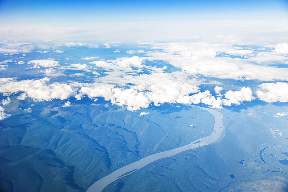 Aerial View Of Green And Snowy Peaks Around The Yukon River As It Runs Through The Alaskan North Slope, Alaska, United States Of America
