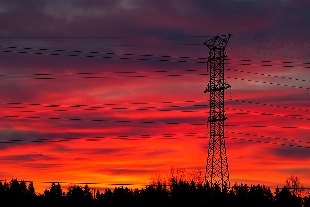 Silhouette Of A Tall Metal Electrical Tower With Colourful Dramatic Sky At Sunrise, Calgary, Alberta, Canada