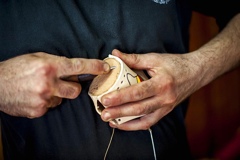 Close Up Of A Man's Hands Making Handicrafts With A Tool, Pelotas, Rio Grande Do Sul, Brazil