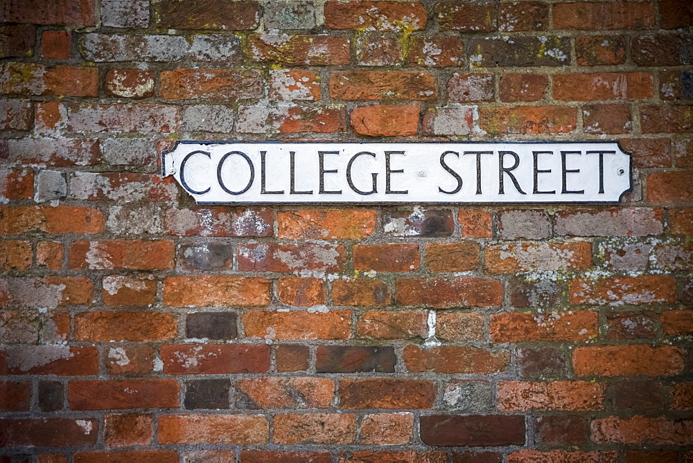 Sign For College Street On A Brick Wall, Winchester, Hampshire, England