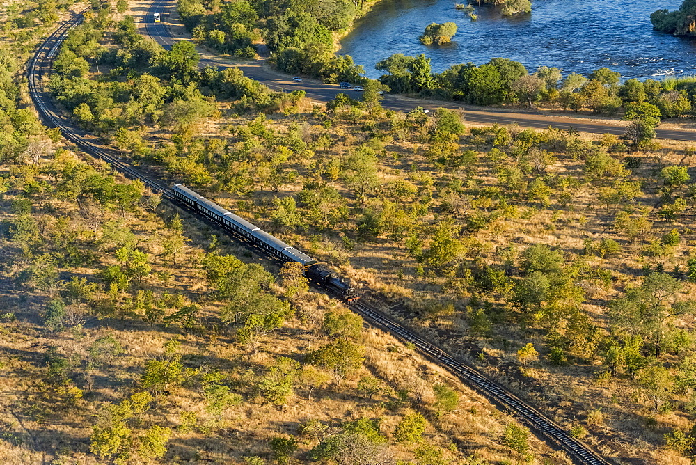 Aerial View Of Steam Train Beside Zambezi, Botswana