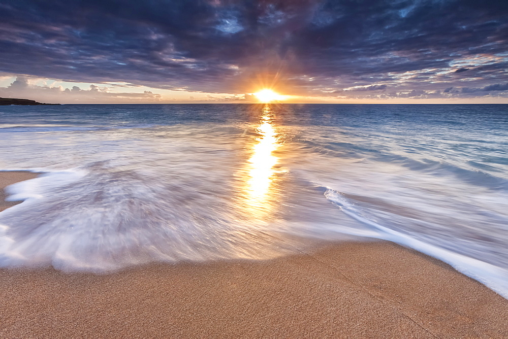Sunlight Reflected On The Ocean To The Sandy Shore At Sunset, Molokai, Hawaii, United States Of America