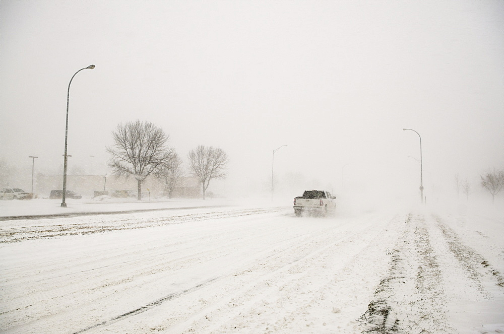 A Truck Driving Through A Blizzard, Grand Forks, North Dakota, United States Of America