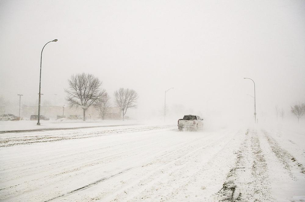 A Truck Driving Through A Blizzard, Grand Forks, North Dakota, United States Of America