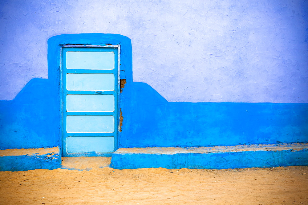 A Colourful Wall To A Nubian Home In A Village On The Nile, Egypt