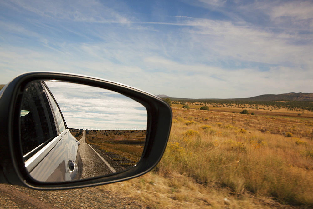Driving Route 66 With Landscape Reflected In Car Mirror, Arizona, United States Of America