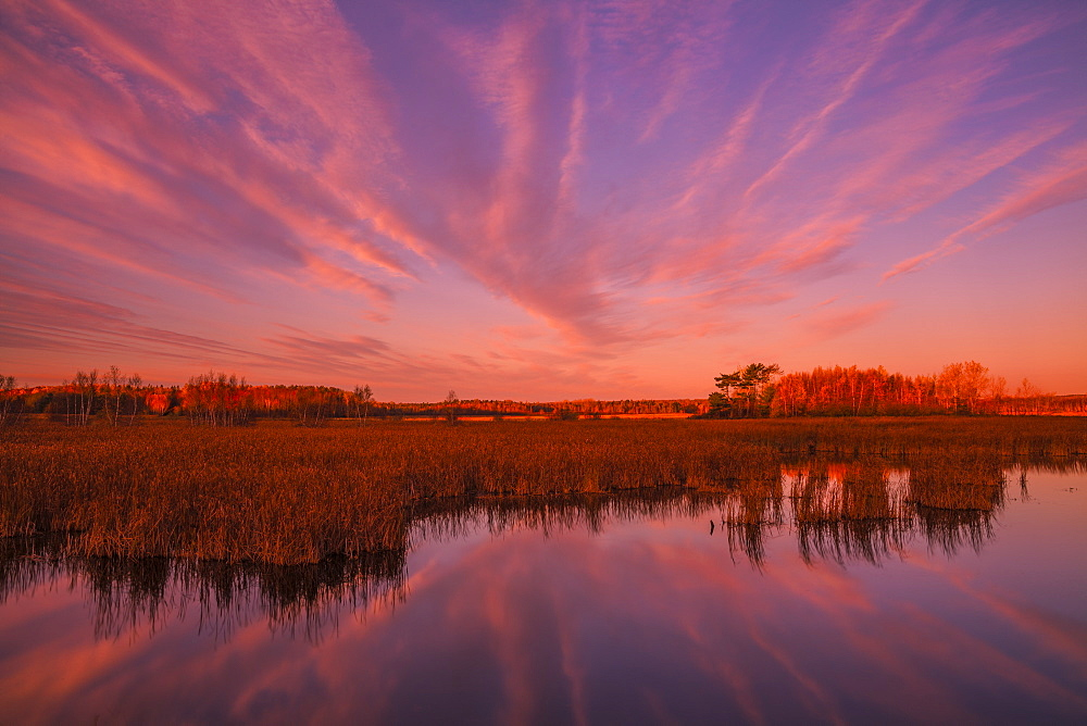 The first moments of sunrise lights up the Maccan River and marsh in late October, Maccan, Nova Scotia, Canada