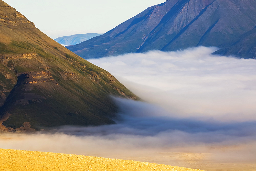 Morning fog blankets the lower Valley of Ten Thousand Smokes in Katmai National Park, Alaska, United States of America