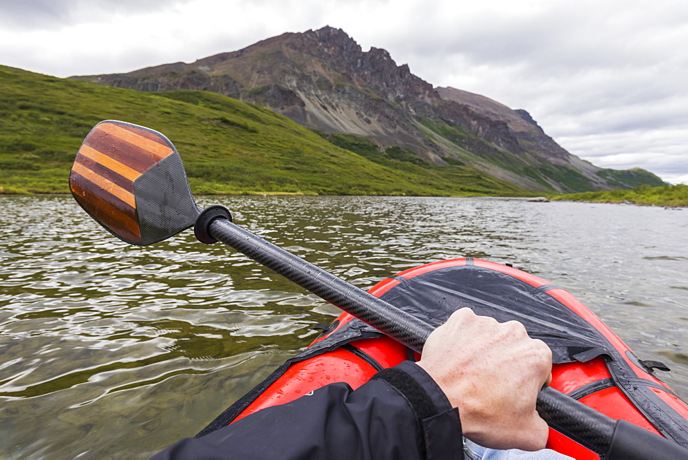 Point of view shot of paddling a pack raft on Landmark Gap Lake near the Denali Highway, Alaska, United States of America