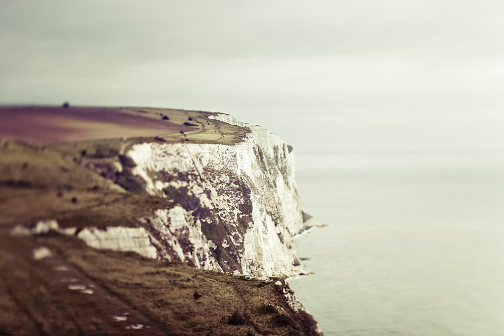 Rugged white cliffs along the coastline, Dover, England