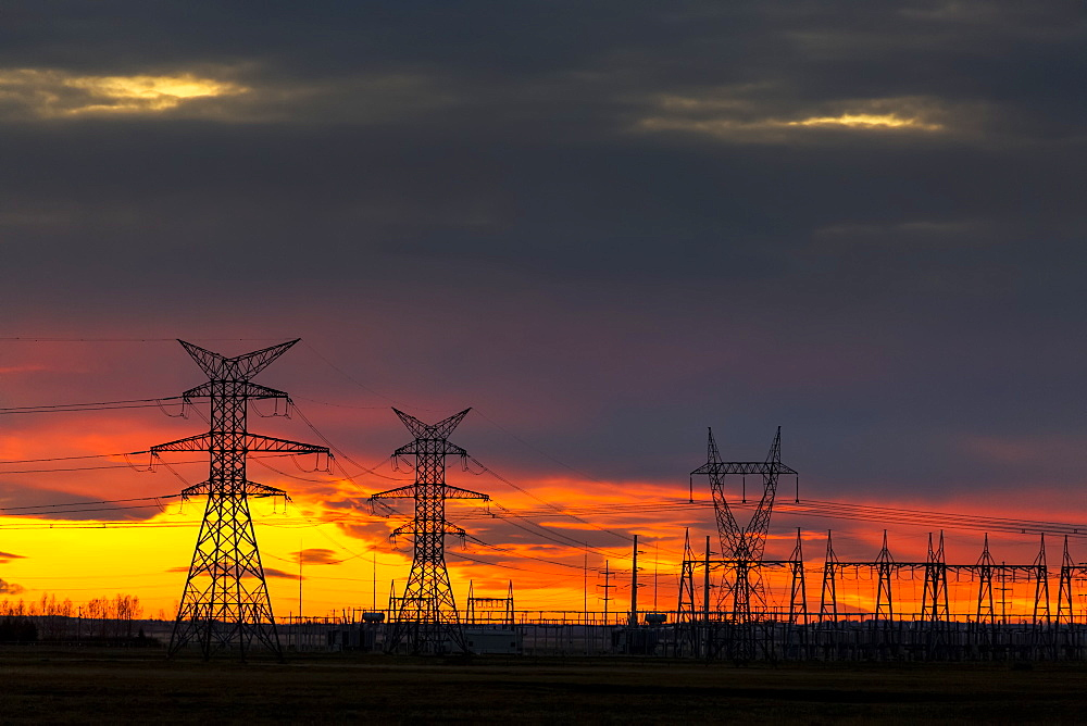 Silhouette Of Large Metal Electrical Towers At Sunset With A Colourful Sky In The Background, Calgary, Alberta, Canada