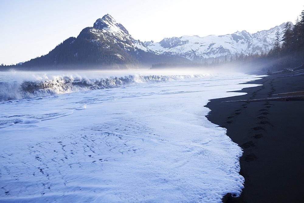 Waves Crashing Onto The Beach Along The Coast Along The Kenai Mountains, Kachemak Bay State Park, Alaska, United States Of America