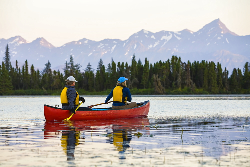 A Couple Canoeing On Stone Step Lake, Homer, Alaska, United States Of America