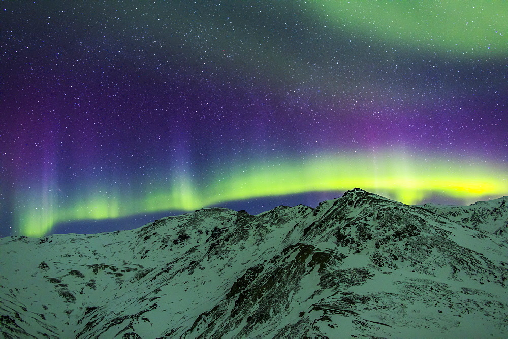 Aurora Borealis Over Mountains Within Denali National Park On A Very Cold Winter Night. The Andromeda Galaxy Is Visible To The Left, Alaska, United States Of America