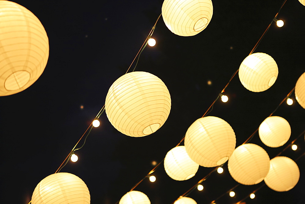 Illuminated Round Lanterns Strung In Rows