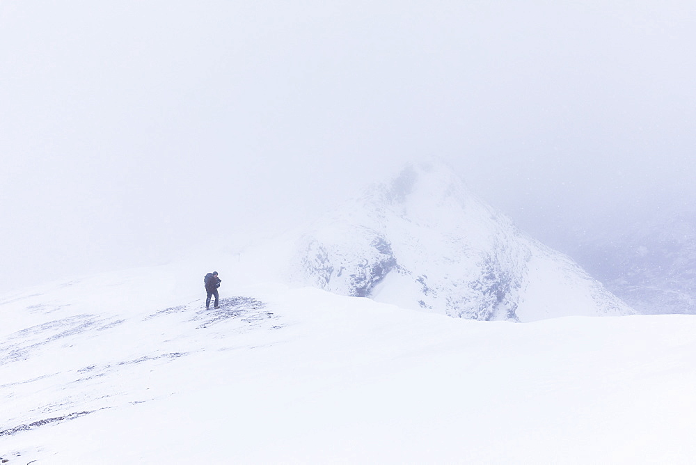 A Hiker Climbs A Ridge High Above Trims Creek In A Portion Of The Alaska Range Known As The 'delta Mountains' In Early Winter, Alaska, United States Of America