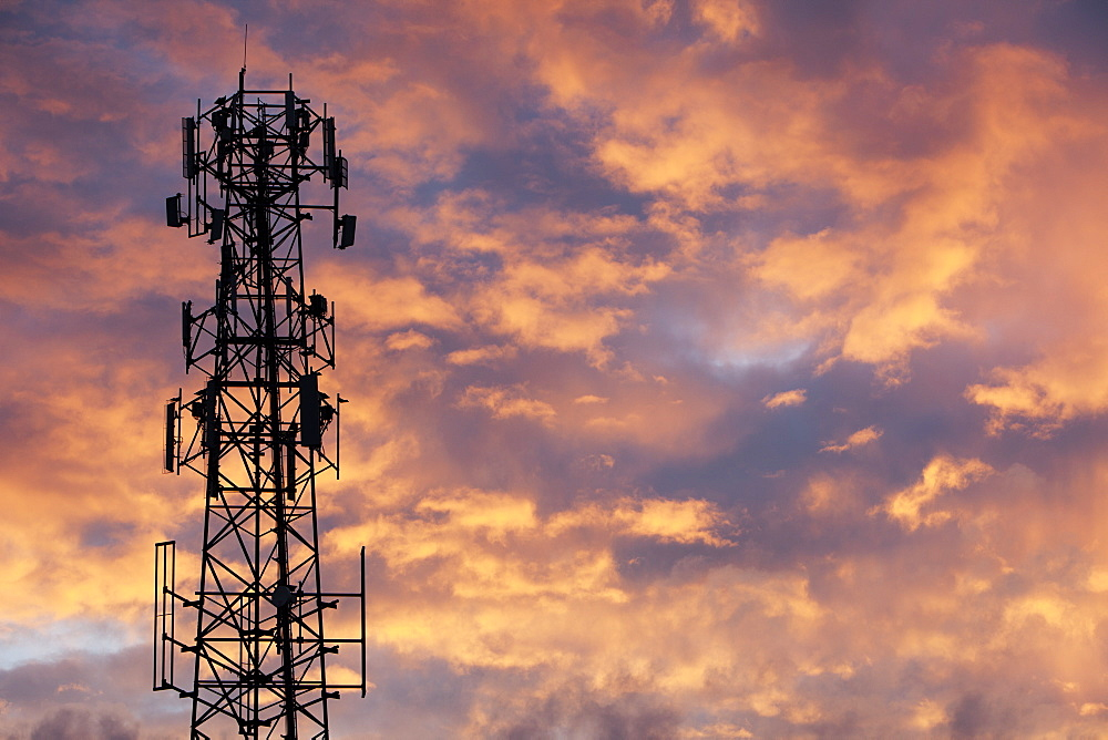 Silhouette Of A Communications Tower With Glowing Pink Clouds At Sunset, Brantford, Ontario, Canada