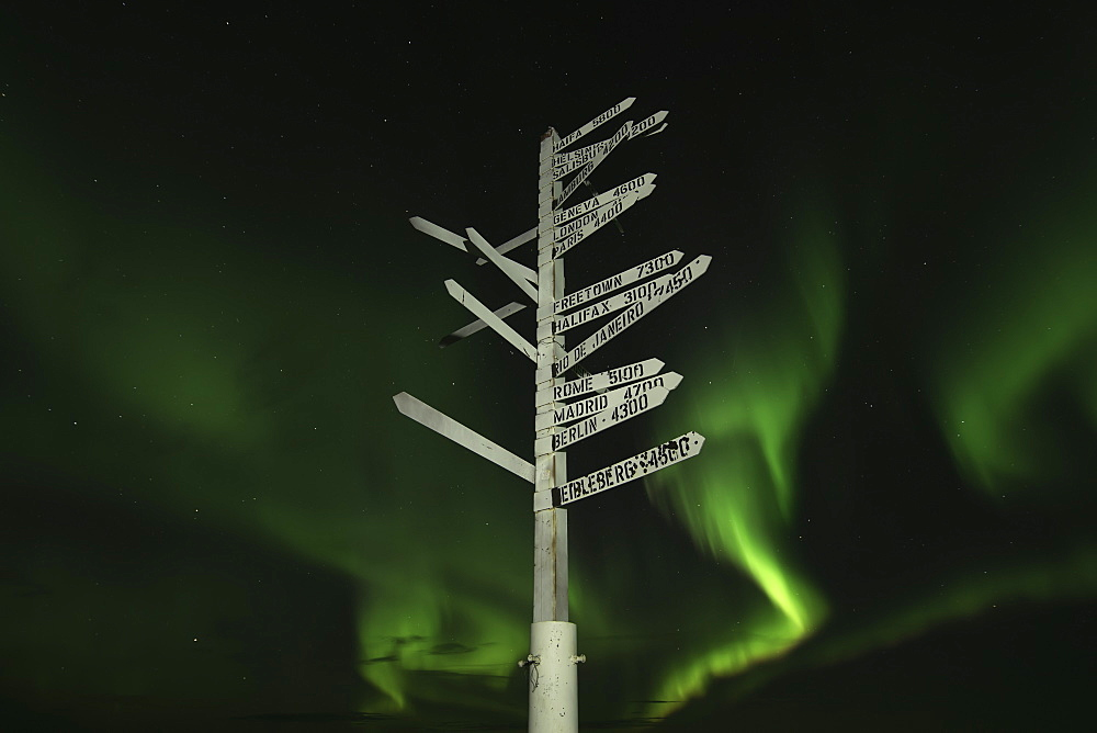 Aurora Borealis In The Sky Above The Signpost On Top Of Keno Hill, Keno, Yukon, Canada