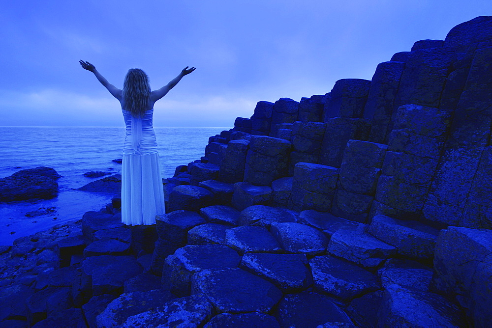 Woman Worshipping By The Sea