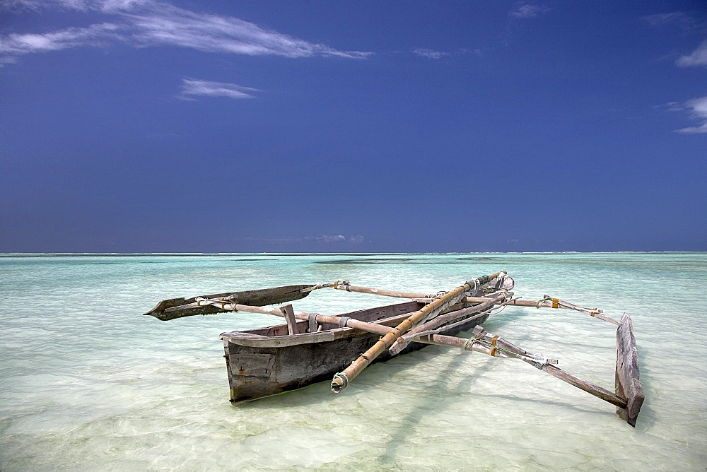 Zanzibar, Africa; Dhow In The Water