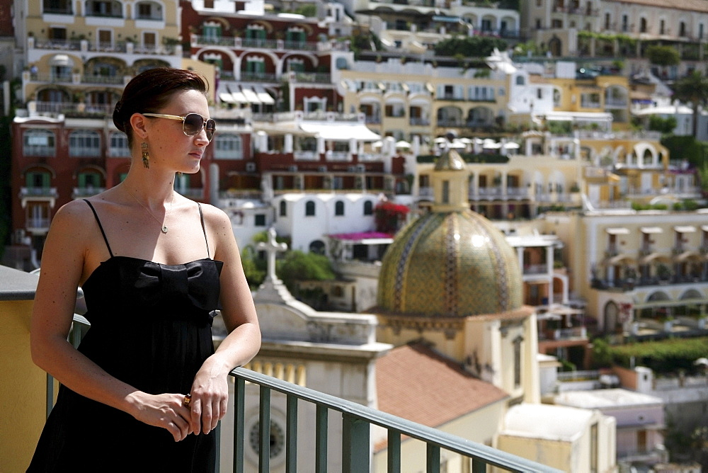 Positano, Campania, Italy; Woman Looking Out At The City